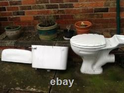 Close coupled toilet, shell shaped lid, cistern, lid, complete
